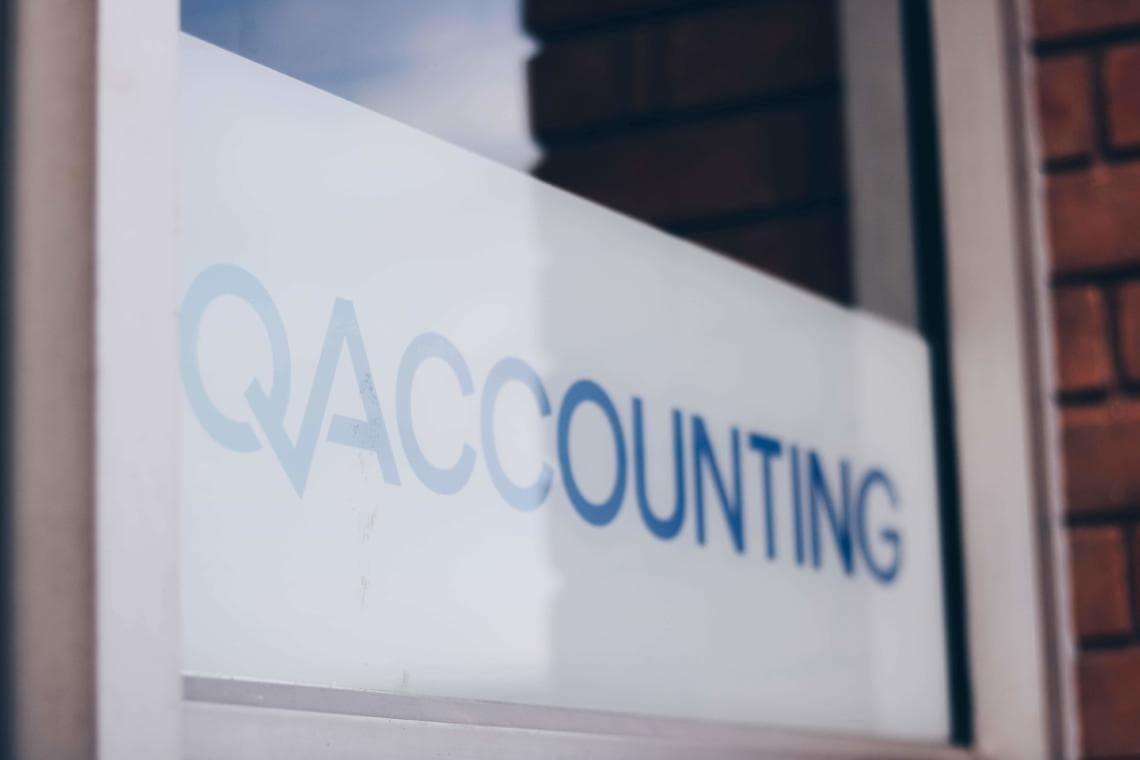 Qaccounting logo at office